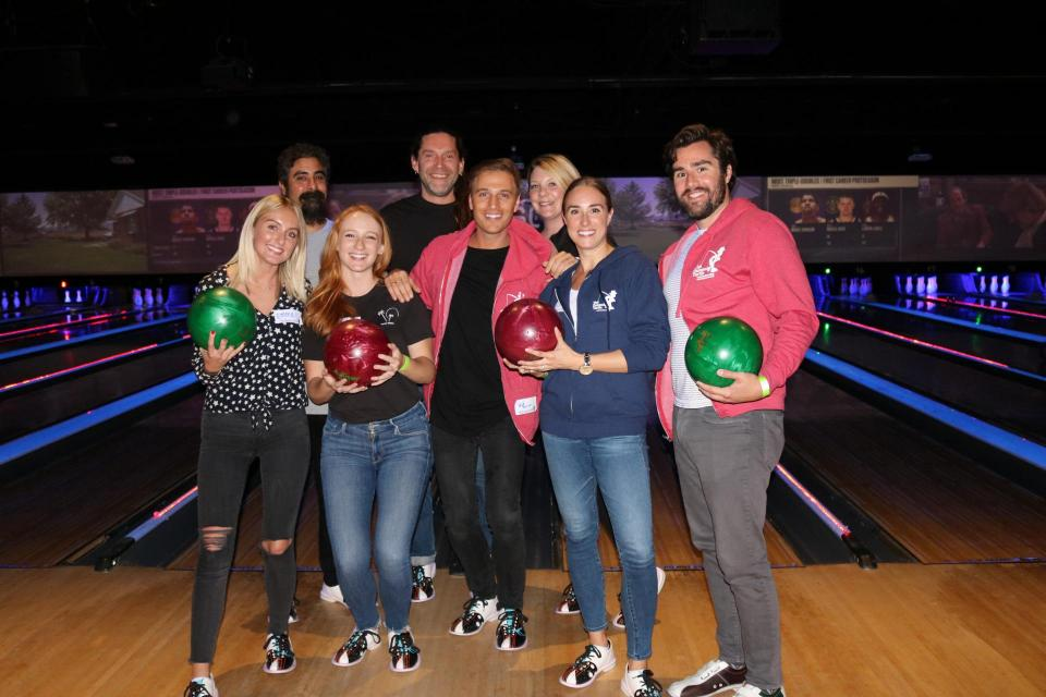 Group of volunteers bowling to raise funds for The Painted Turtle