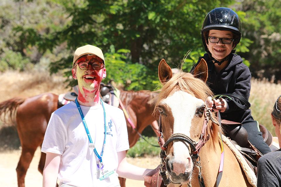 Boy on horseback with Counselor