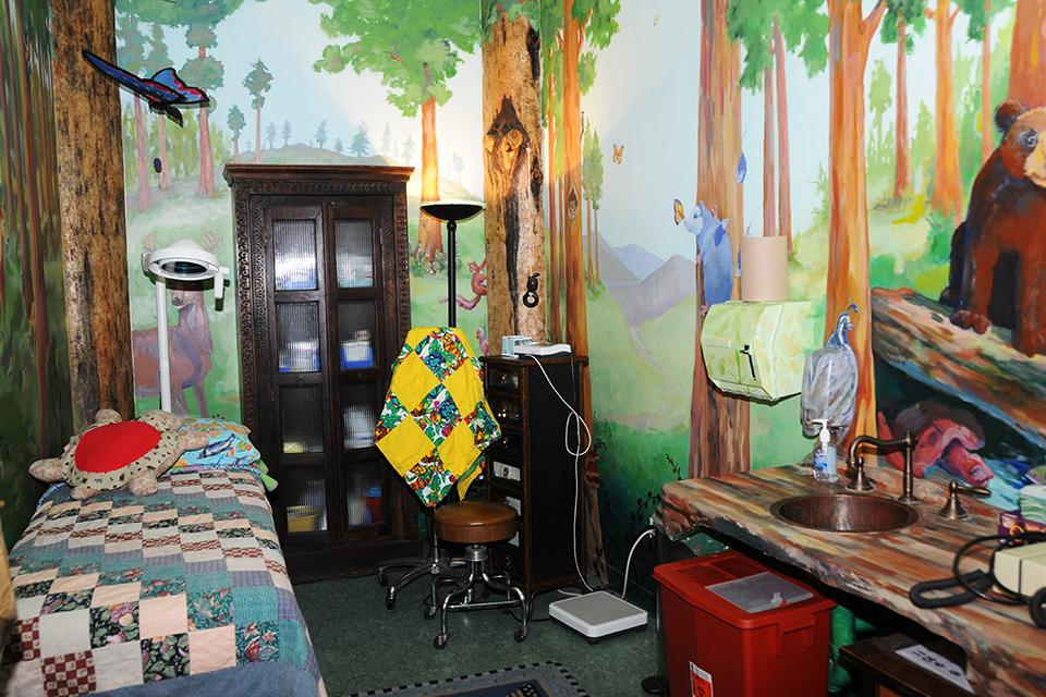 The Treeage Room contains  a forest of animals and birds.